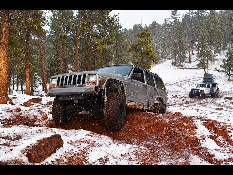 XJ on 33s no lift! takes on RainbowFalls in Snow!