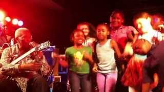 Children dancing onstage with BB King