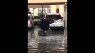 Man in trolley during Dubai rain