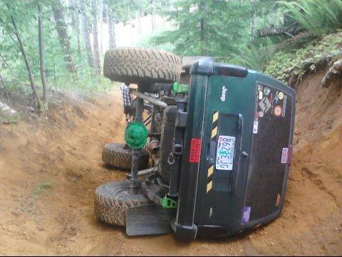 Jeep cherokee xj rolls flip over funny  no hands!!