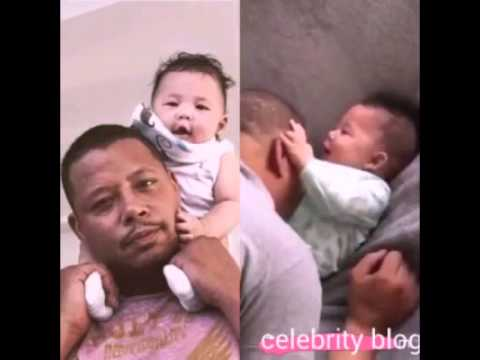 Terrence Howard playing with his baby son