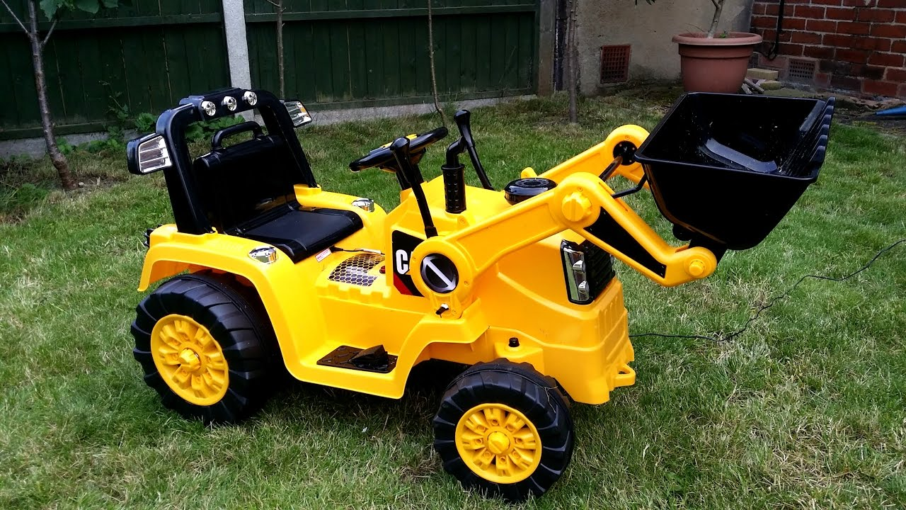 Power Wheels Ride On Tractor : Toddler playing with huge digger tractor ride on