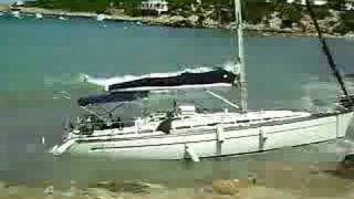 Yacht On Rocks