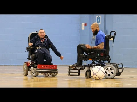 Tim Howard tries out powered wheelchair football!