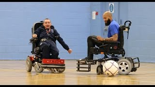 Tim Howard tries his hand at powered wheelchair football