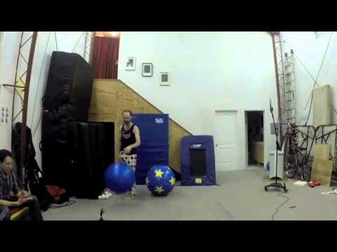 Juggling Six Clubs on Rolling Globe - Leo James