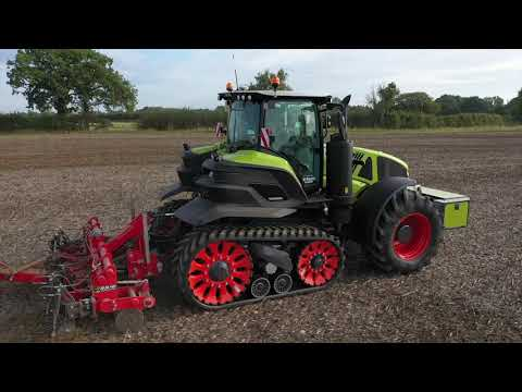 Claas Axion 960 TT Terratrac working in the UK with 12 meter Vaderstad Carrier.