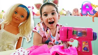 Anna and Doll Play with Toy Sewing machine