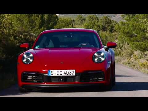 The new Porsche 911 Carrera 4S in Guards Red on the Country Road