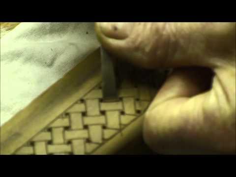 carving a basket weave pattern on a gunstock