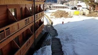 Горнолыжный курорт Архыз Отель Arkhyz Royal Resort Spa Вид с квадрокоптера Пролет за отелем