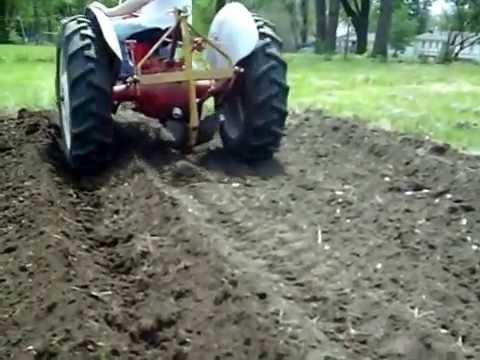 Making garden rows with a middle buster plow  1949 8N Ford