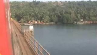 Rajdhani Express in Konkan Railway crosses 2 bridges & 2 tunnels in 2 minutes