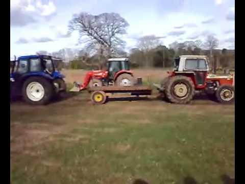 Máy cày thi kéo : Máy Cày New Holland 115 Và Massey Ferguson 390 Turbo.mp4