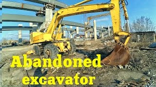 Abandoned excavator. Abandoned and forgotten steam shovel. Abandoned heavy equipment