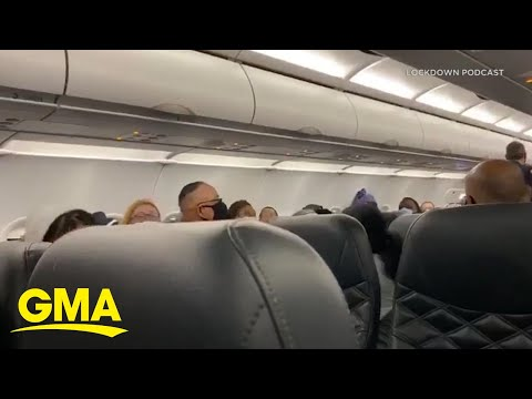 Officers remove non mask-wearing passenger from flight l GMA