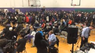 "Residents chant ""No justice, no peace"" at Cleveland community meeting"