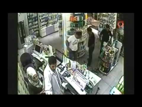 Syrian officials attacking a working woman in a pharmacy