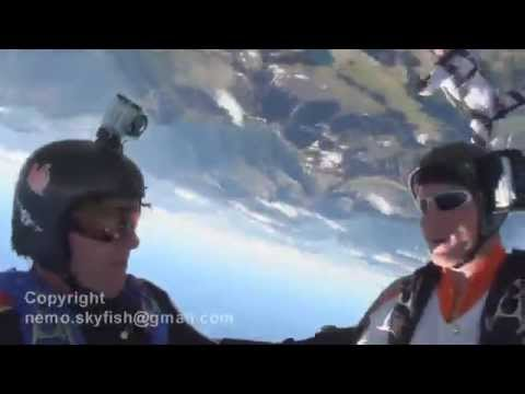 Skydiver's near impact and landing on top of a mountain