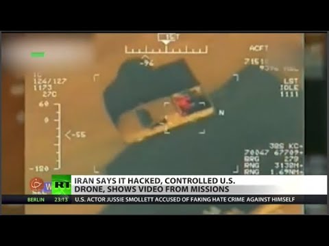 RT America: ISIS execution revealed in hacked drone footage