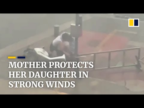 Mother uses body to protect daughter in strong winds in China