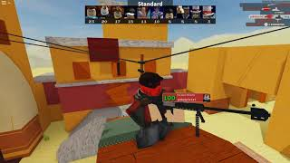 Playing Roblox Arsenal While Paintball man is hypnotized
