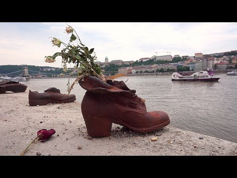 WHY ARE THERE SHOES ON THE EDGE OF THE DANUBE?