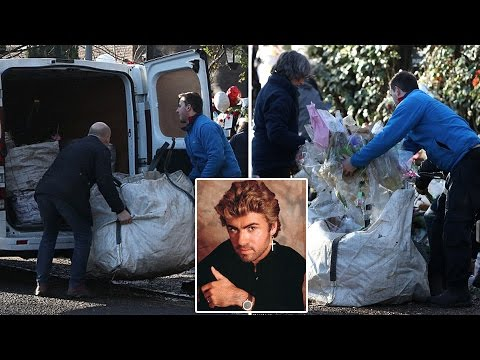 Sea of floral tributes is cleared from outside George Michael's home