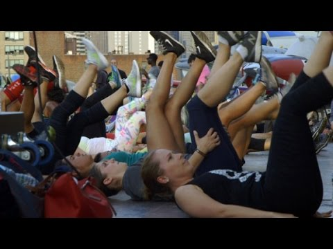 Hundreds do burpees on the USS Intrepid