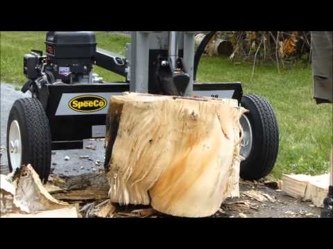 Logsplitter- Speedco 28 ton handling some really gnarly wood