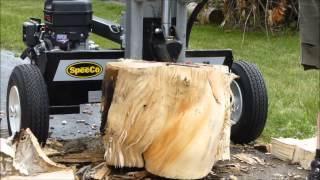 Logsplitter- Speedco 28 ton handling some really gnarly wood