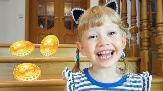 Alena y Pasha jugando un nuevo juego con monedas