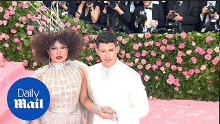 Nick Jonas holds onto wife Priyanka Chopra at the 2019 Met Gala