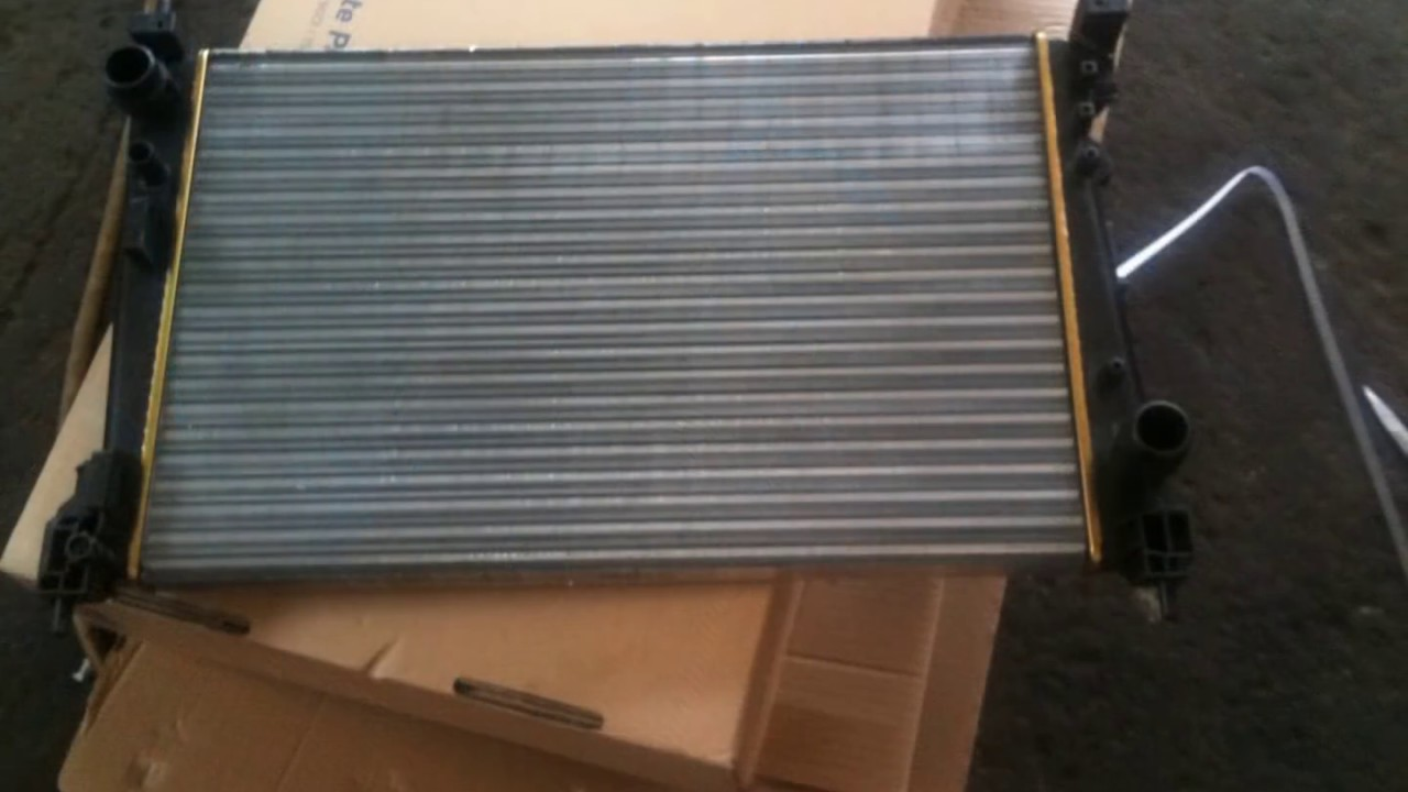 replacement cooling radiator opel corsa 1.3cdti 2008 - YouTube