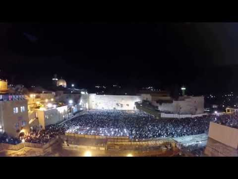 Thousands pray at the Western Wall in Jerusalem before the start of Yom Kippur