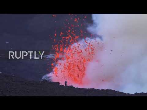 Italy: Mount Etna spews ash and lava into air as eruption continues
