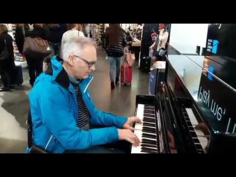 """""""Play me, I'm yours."""" (Freewheeling on the piano in Charleroi Airport)"""