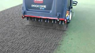 Core aerifying the practice green @ Shadow Wood Preserve, Ft. Myers FL 6-1-2011