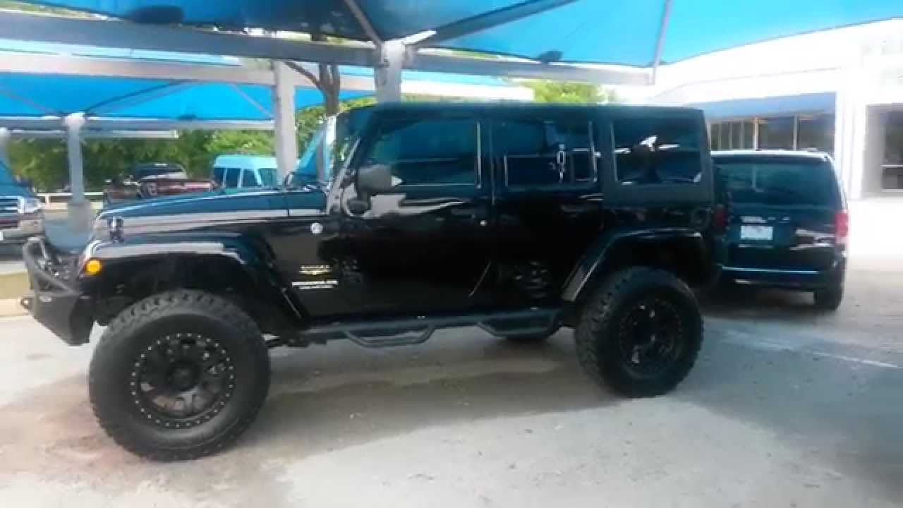 $33,991 tricked out lifted black 2013 jeep sahara wrangler tdy