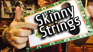 skinny strings on a cigar box guitar