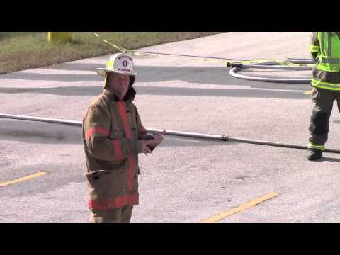 Firefighter explain demo of fires with and without sprinkler