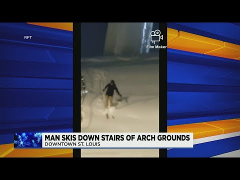 WATCH-Man-skis-down-Arch-grounds-steps