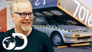 Can A Domino Chain Reaction Be Used To Crush A Car?! | MythBusters Jr.