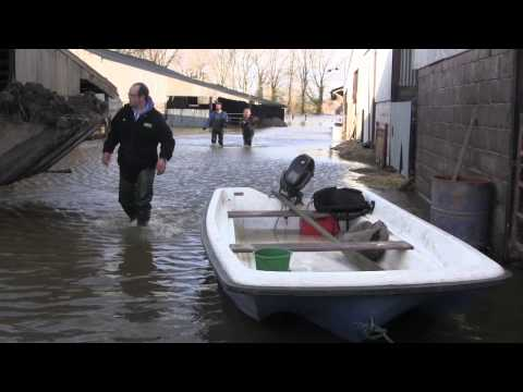 Treacherous boat trip to abandoned flood-hit farm