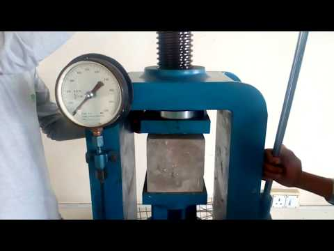 COMPRESSIVE STRENGTH TESTING WITH TESTING MACHINE