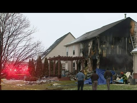 Emergency crews investigate after small plane crashes into Lyon Township home