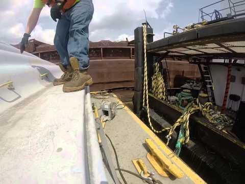 Tug life. Cutting a barge loose