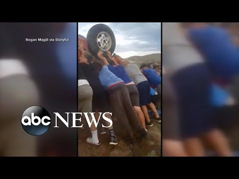 Youth football team saves couple in overturned car