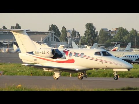 Charter jet steering at airport, planes parked on background. Stock Footage