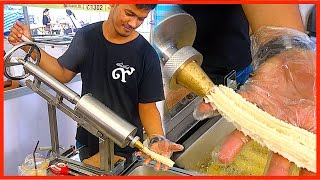 Street food - Magic Making Machine Doughstick with Teh Tarik in Dessert Event